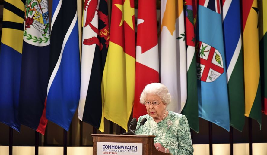 Britain's Queen Elizabeth II speaks during the formal opening of the Commonwealth Heads of Government Meeting in the ballroom at Buckingham Palace in London, Thursday April 19, 2018