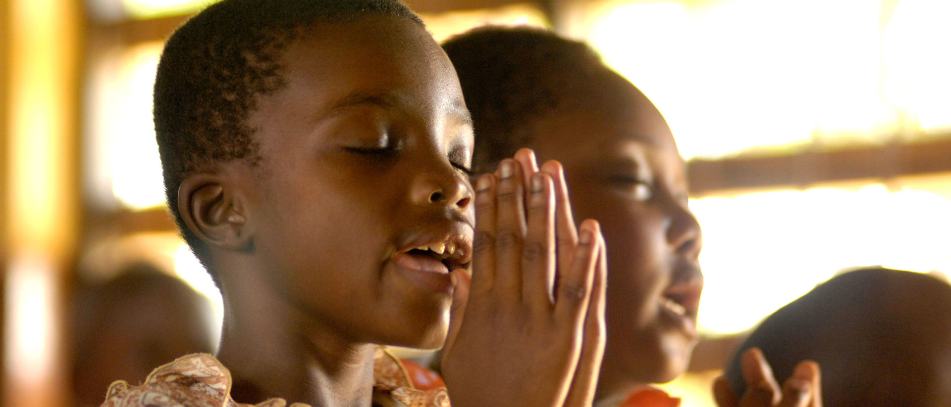 Ghanaian children praying