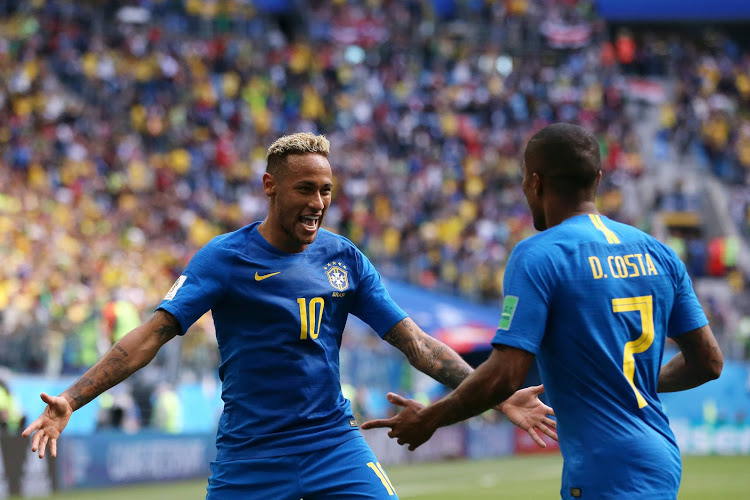 Neymar Jr of Brazil celebrates with teammate Douglas Costa after scoring his team's second goal during the 2018 FIFA World Cup Russia group E match