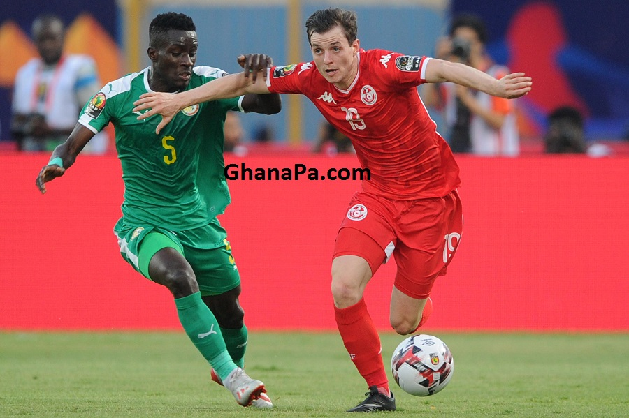 Ben Mohamed Ayman of Tunisia is challenged by Idrissa Gana Gueye of Senegal during the Africa Cup of Nations 2019 Finals semifinal game between Senegal and Tunisia at 30 June Stadium in Cairo, Egypt.