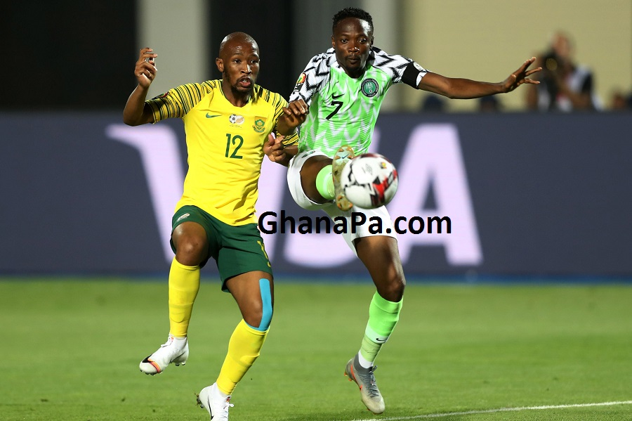 Ahmed Musa of Nigeria challenged by Kamohelo Mokotjo of South Africa during the 2019 Africa Cup of Nations Finals, quarterfinals match between Nigeria and South Africa at Cairo International Stadium, Cairo, Egypt.