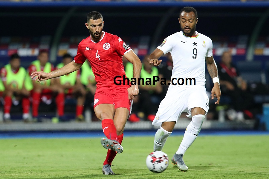 Yassine Merriah of Tunisia challenged by Jordan Ayew of Ghana during the 2019 Africa Cup of Nations Last 16 match between Ghana and Tunisia at the Ismailia Stadium, Egypt.