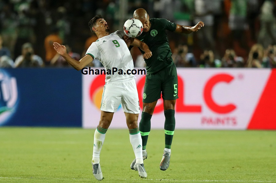 Baghdad Bounedjah of Algeria challenged by William Paul Ekong of Nigeria during the 2019 Africa Cup of Nations Finals, Semifinals match between Algeria and Nigeria at Cairo International Stadium, Cairo, Egypt.